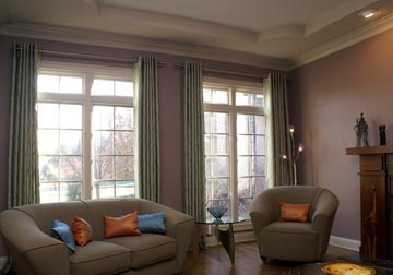 custom window treatments with drapery panels and grommets and Busche rods in Glenview by Spiritcraft Interior Design in Crystal Lake and Barrington, Illinois